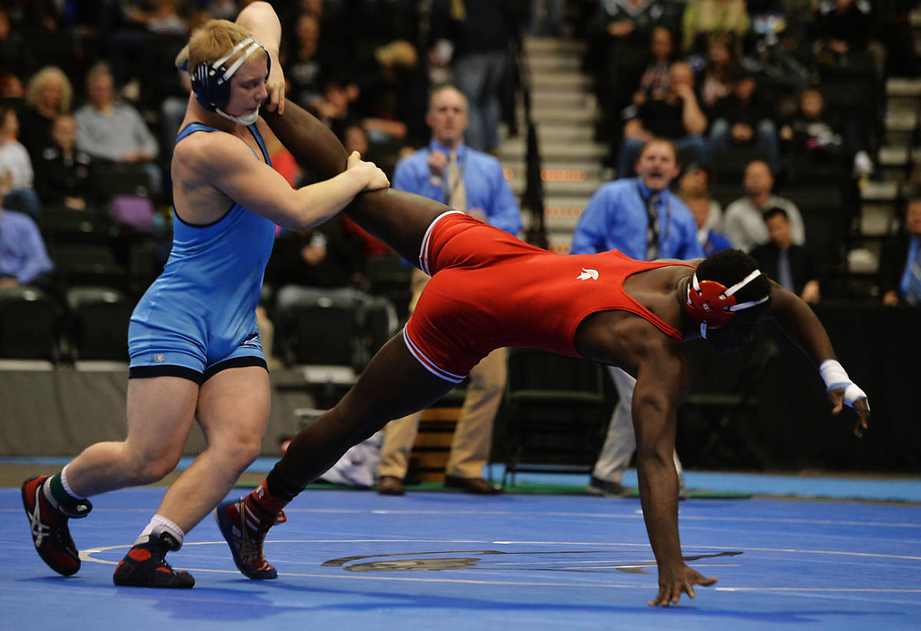 . Zimmerman junior Austin May picks up the leg of Simley senior Trom Peterson to claim the class AA 182 pound State Wrestling Championship at the Xcel Energy Center in St. Paul , Saturday, March 1, 2014. May would earn the victory with an 8-4 decision. (Pioneer Press: John Autey)