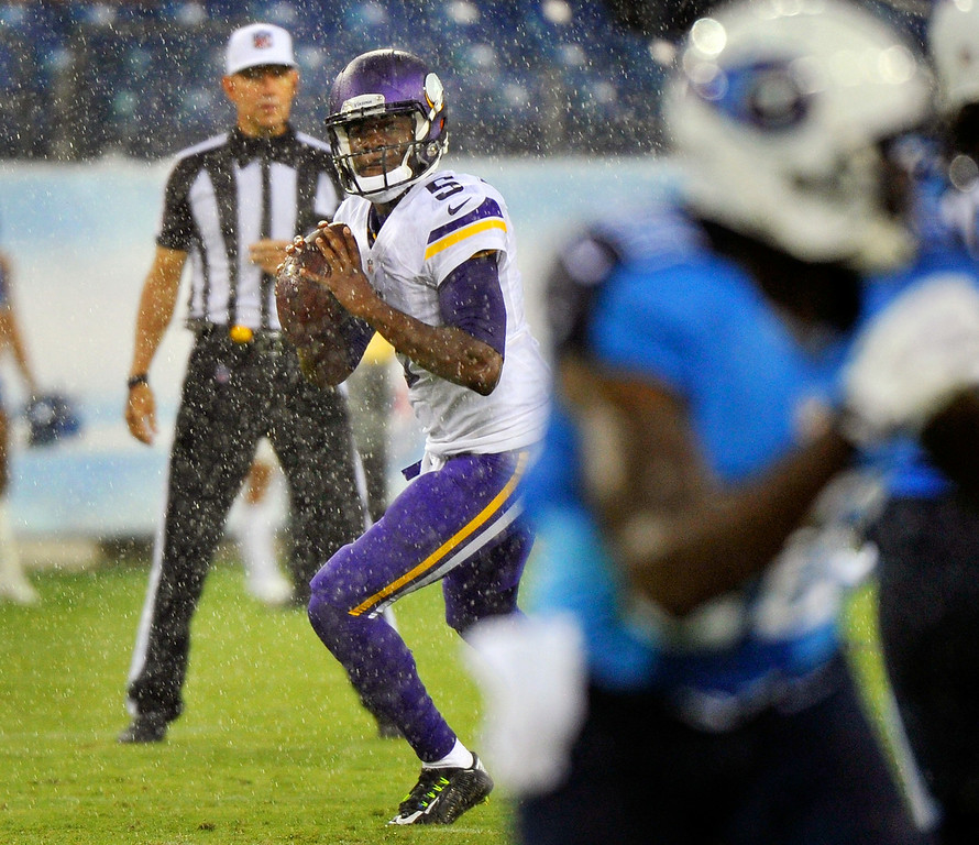 . Quarterback Teddy Bridgewater of the Minnesota Vikings rolls out to throw a pass against the Tennessee Titans. (Photo by Frederick Breedon/Getty Images)