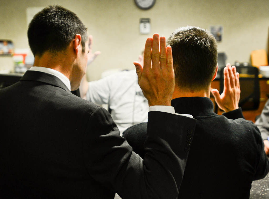 . Zimmerman, left, and Melchert pledge that the information is accurate on their application for a marriage license.  (Pioneer Press: Ben Garvin)