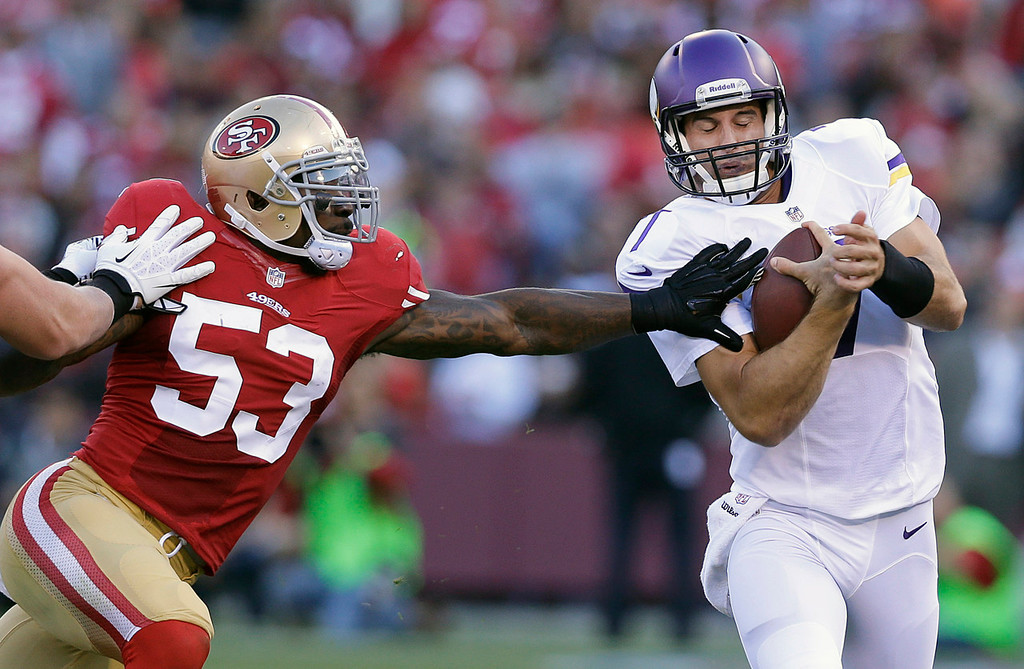 . 49ers linebacker NaVorro Bowman, left, pushes Vikings quarterback Christian Ponder out of bounds during the second quarter. (AP Photo/Marcio Jose Sanchez)