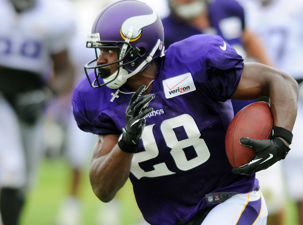 . Running back Adrian Peterson rushes on Day 4 of Vikings training camp at Minnesota State University in Mankato on Tuesday, July 30, 2013.  (Pioneer Press: John Autey)