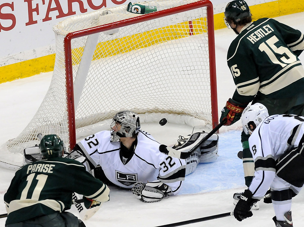 . Minnesota Wild left wing Zach Parise (11) scores on Los Angeles Kings goalie Jonathan Quick (32) as Dany Heatley watches during the third period. (Pioneer Press: Sherri LaRose-Chiglo)