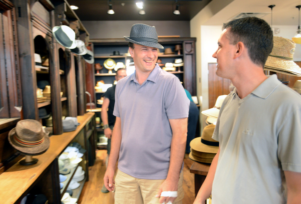 . Bradley Weber, left, gets a mixed review from Ryan Pfeifle, who is not entirely pleased with the look, while shopping for wedding attire.  (Pioneer Press: Chris Polydoroff)