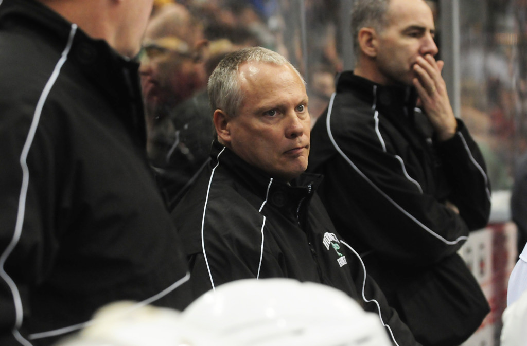 . Edina head coach Curt Giles, center, watches his team in the second period against Lakeville North.  (Pioneer Press: Scott Takushi)