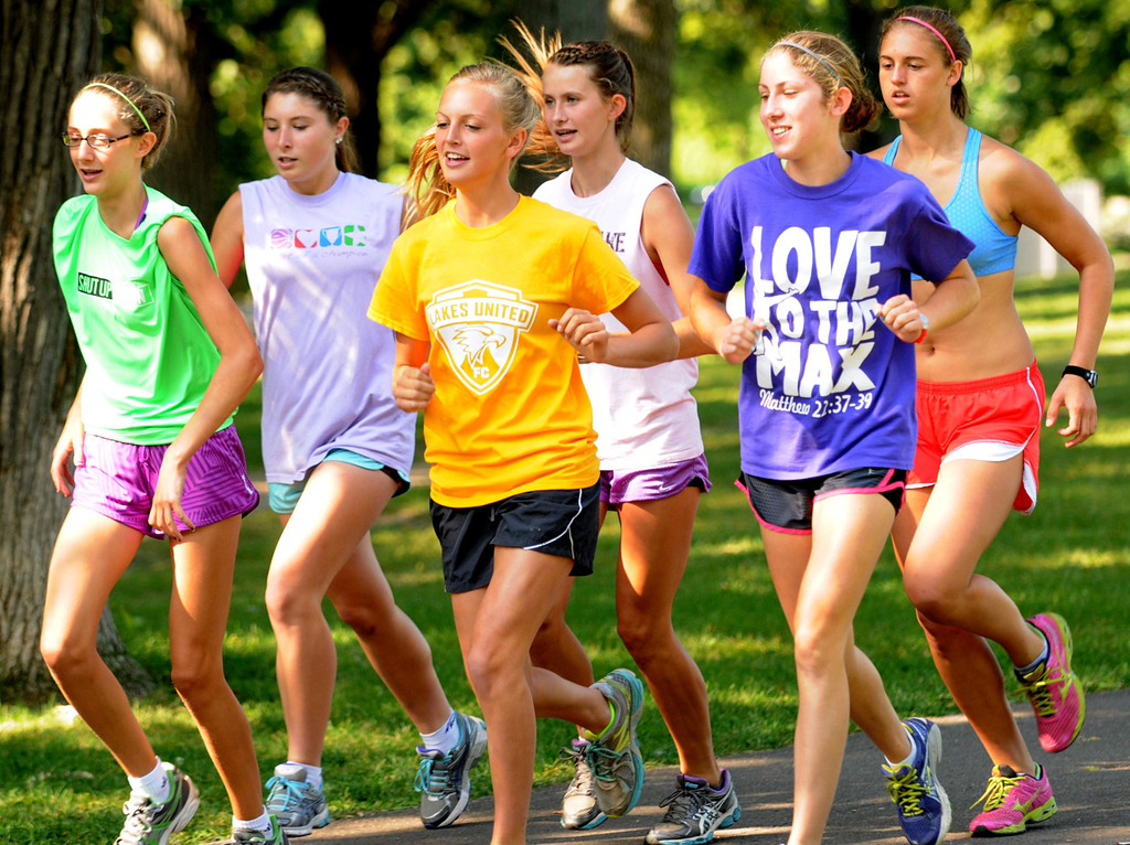 . Forest Lake girls cross country teammates (from left)  freshman Alison Bartlett, freshamn Miranda Overland, sophomore Emma Benner, freshman Abi Asperheim, freshman Maria Valentin and junior Molly Mead take off on a hilly run during a team practice at Minnehaha Falls Park. (Pioneer Press: Jean Pieri)