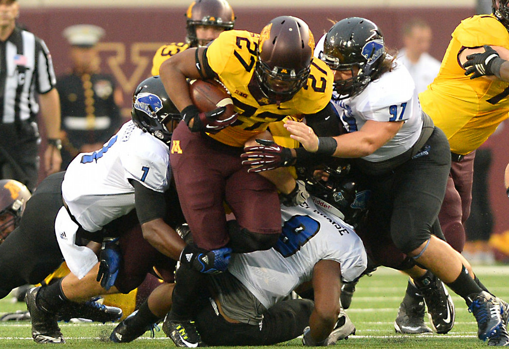. Minnesota running back David Cobb rushes for a first down against Eastern Illinois in the first quarter.  (Pioneer Press: John Autey)
