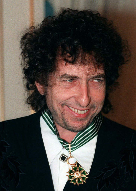 . **FILE** Bob Dylan smiles as he is named a Commander in France\'s Order of Arts and Letters in this Jan. 30, 1990 file photo. A collection of Dylan\'s artworks, including variations on published drawings and sketches, is to open later this year at a museum in the eastern German city of Chemnitz, Wednesday, Aug. 8, 2007. (AP Photo/ Lionel Cironeau, file)