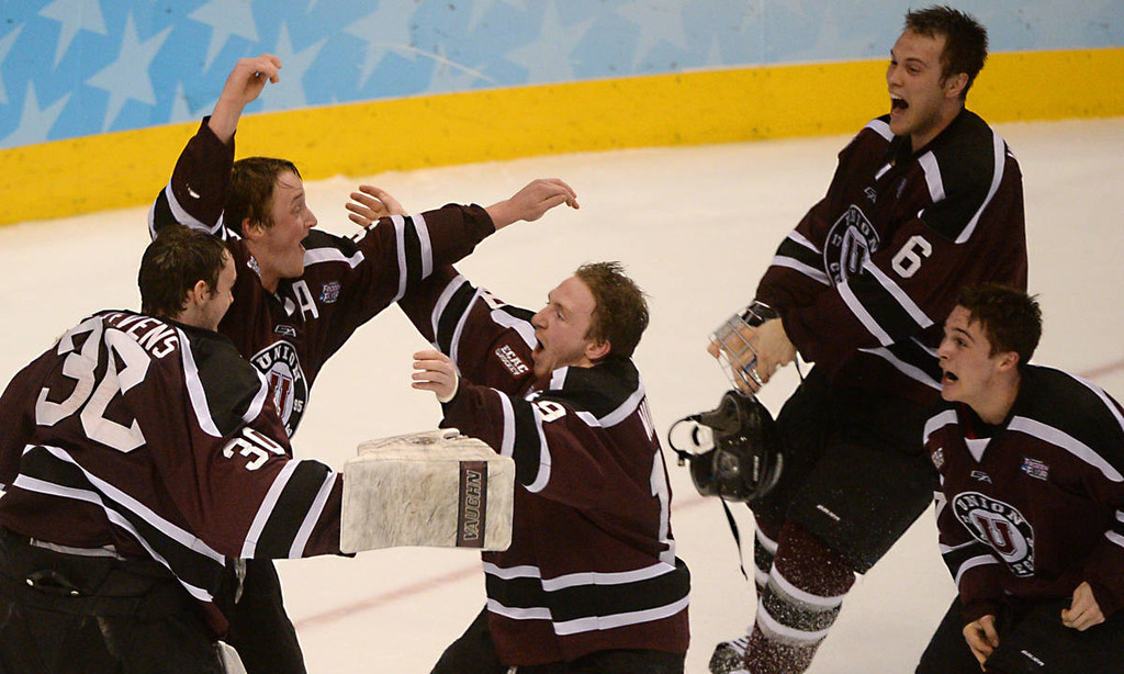 . Union College hockey players celebrate their 7-4 victory over the Gophers in the  NCAA Frozen Four Championship Game at the Wells Fargo Center in Philadelphia, Saturday, April 12, 2014.  (Pioneer Press: John Autey)