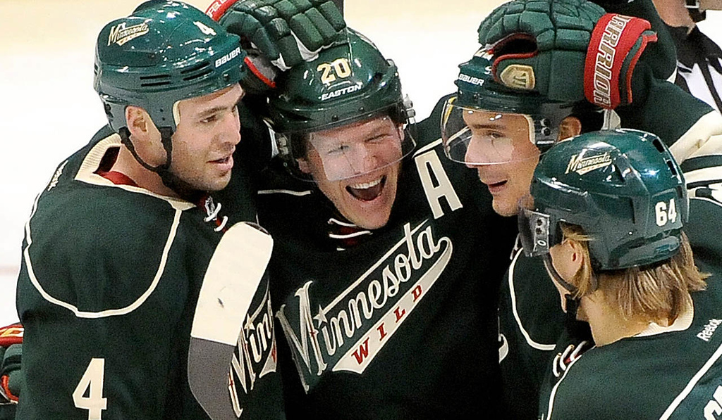 . Minnesota Wild  Ryan Suter, middle left, celebrates his hat track with teammates Clayton Stoner, left, Nino Niederreiter, middle right, and Mikael Granlund, right, during the third period on January 4, 2014 at the Xcel Energy Center Arena in downtown St. Paul.  (Pioneer Press: Sherri LaRose-Chiglo)