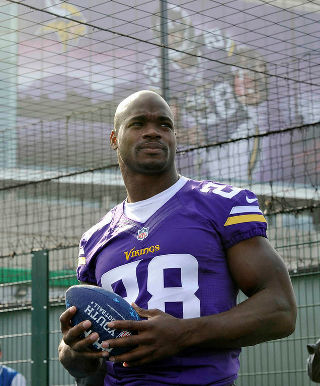 . Vikings running back Adrian Peterson, with a gigantic photograph of himself on the side of Wembley Stadium in London. (NFL: Sean Ryan)
