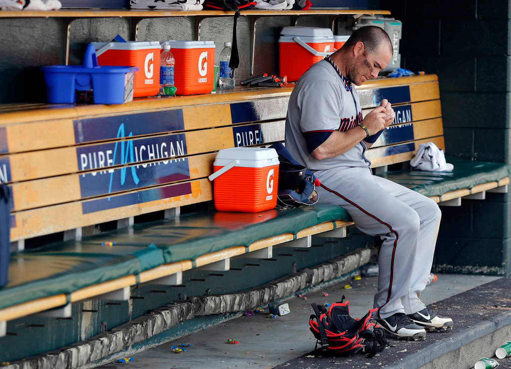 . Ryan Doumit, of the Minnesota Twins, sits in the dugout following their 6-1 loss to the Detroit Tigers at Comerica Park. (Photo by Duane Burleson/Getty Images)