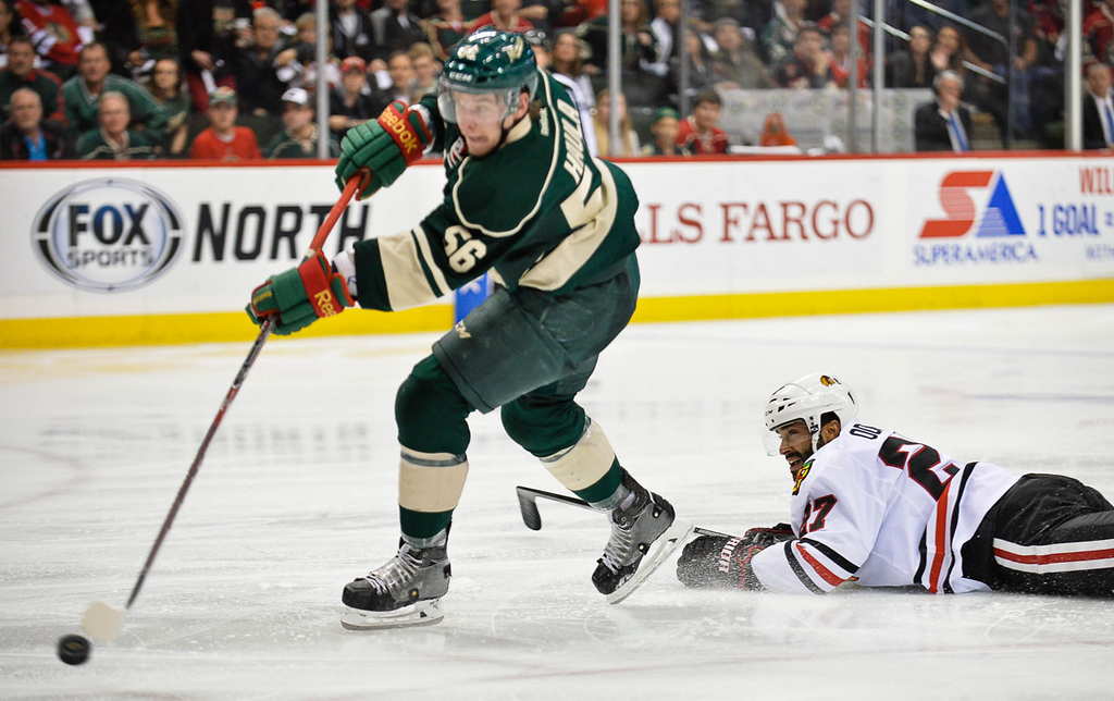. Wild left wing Erik Haula lets his shot go for a goal on a breakaway after leaving Blackhawks defenseman Johnny Oduya behind during the second period. (Pioneer Press: Ben Garvin)