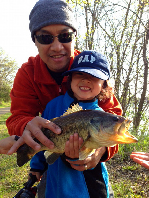 . Braxton Viravong, 5, of Carver County caught this largemouth bass -- his first fish on his new Spider-Man rod -- in early June on Lake Marion in Lakeville. Helping with the pose is his father, Leo Viravong. (Photo courtesy Leo Viravong)