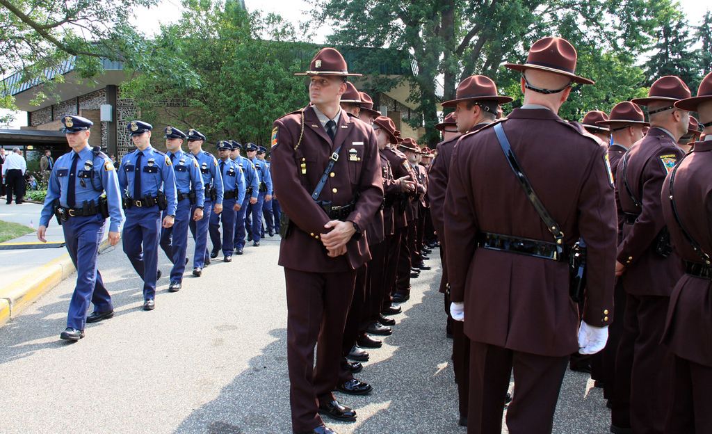 . Law enforcement agencies from around the state were present at St. Stephen\'s Lutheran Church in West St. Paul for the funeral of Mendota Heights police officer Scott Patrick on Wednesday.  (Minnesota Department of Public Safety Pool Photo: Jen Longaecker)