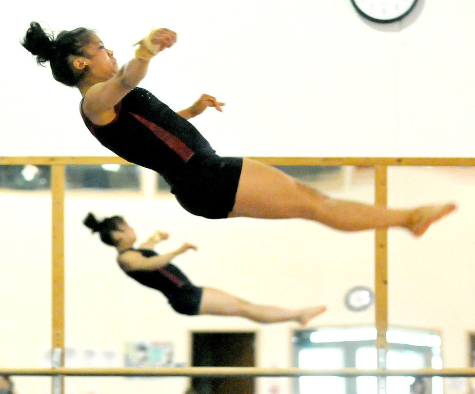 . Gymnast Mary Jane Rott works on her floor exercise routine. (Pioneer Press: John Doman)