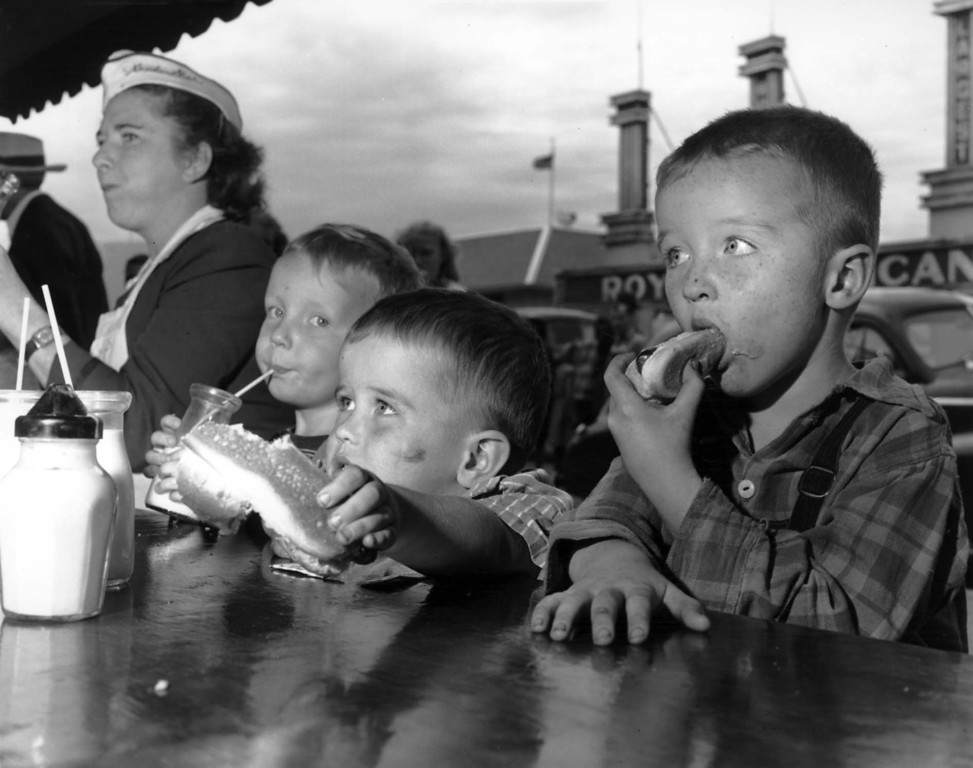 . Kids eat hot dogs at a food stand on the fairgrounds, Minnesota State Fair, 1947. Photo courtesy of the Minnesota State Fair.