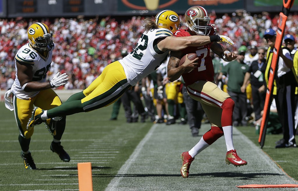""". <p><b> Green Bay linebacker Clay Matthews could be facing a fine or suspension for his � </b> <p> A. Out of bounds hit on San Francisco�s Colin Kaepernick on Sunday  <p> B. Girlish slap at 49ers lineman Joe Staley  <p> C. Excessive posing for his next Fathead poster  <p><b><a href=\'http://www.twincities.com/sports/ci_24058516/green-bay-packers-clay-matthews-hit-sparks-war\' target=\""""_blank\"""">HUH?</a></b> <p>    (AP Photo/Ben Margot)"""
