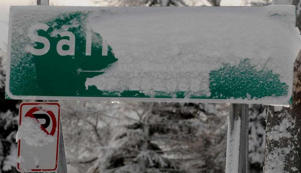 """. Snow covers this \""""Saint Paul\"""" sign at the city\'s edge, at Arcade and Larpenteur. Both St. Paul and Minneapolis declared snow emergencies Thursday afternoon.  (Pioneer Press: Jean Pieri)"""