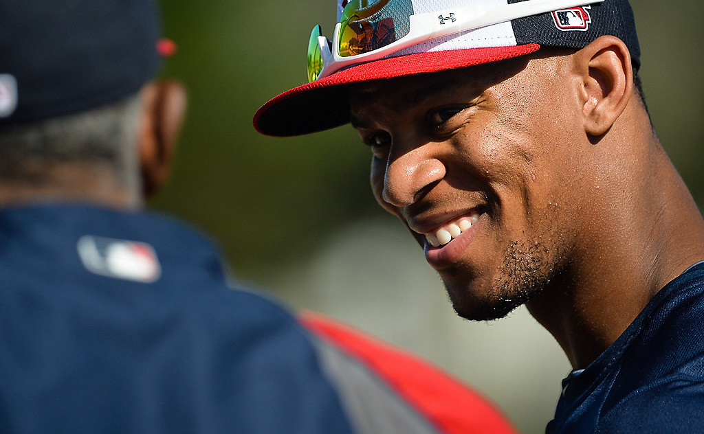 . Twins rookie and top prospect Byron Buxton is chatted up by former Twins great Tony Oliva during spring training at Hammond Stadium in Fort Myers, Fla., on Thursday, February 20, 2014. (Pioneer Press: Ben Garvin)