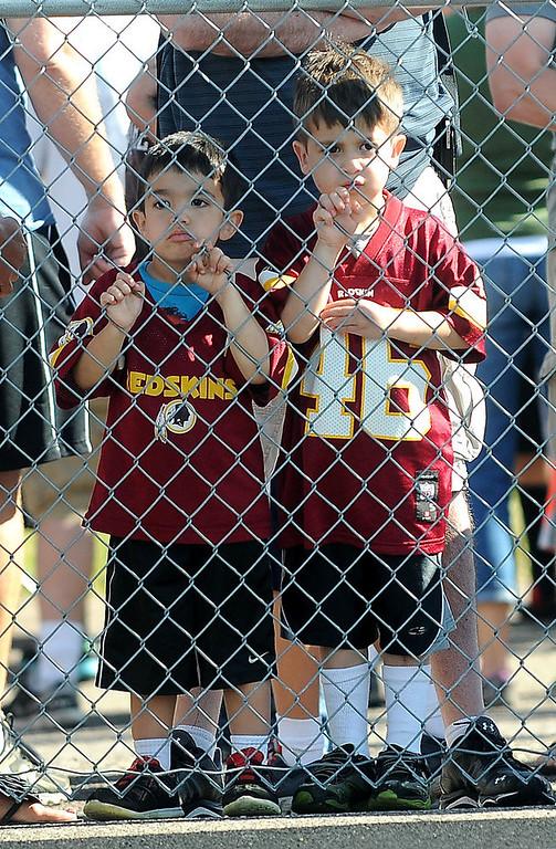 . Samuel Dexter, 3, left, and brother Matthew, 4, watch thrrough the fence. (Pioneer Press: Sherri LaRose-Chiglo)