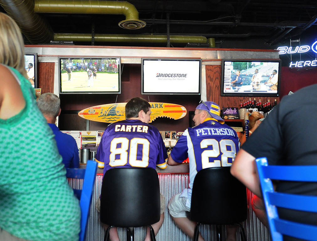 . Friends James Brodin, left, and Chris Roadehaver hold forth at Johnny B\'s restaurant before a Vikings scrimmage in Mankato. (Pioneer Press: Sherri LaRose-Chiglo)