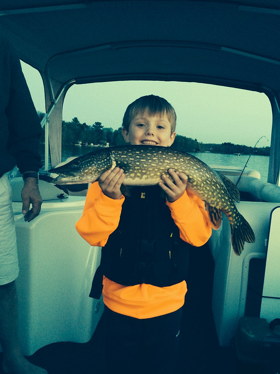 """. Henry Wielinski, 7, of Rosemount caught his first Northern Pike, a 4-pounder, while fishing for bass on Bear Trap Lake in Amery, Wis. His younger brother Charlie, 5, was a \""""huge help in landing it,\"""" the family reports. (Photo courtesy Travis Wielisnki)"""