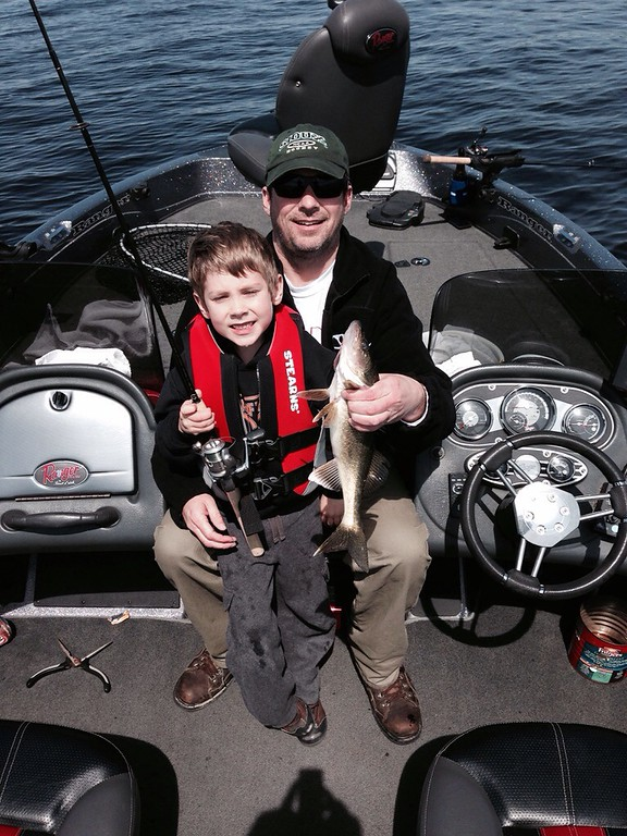""". Thomas Beyer, 6, of Brooklyn Park shows off his first \""""unassisted\"""" walleye, caught while fishing with dad, Steve, May 10, on Red Lake. (Photo courtesy Steve Beyer)"""