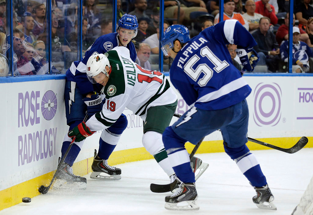 . Minnesota Wild center Stephane Veilleux (19) works between Tampa Bay Lightning defenseman Andrej Sustr (62), of the Czech Reublic, and center Valtteri Filppula (51), of Finland, along the boards during the first period. (AP Photo/Chris O\'Meara)
