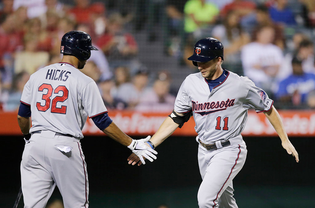 . Minnesota Twins\' Clete Thomas, right, celebrates his home run with Aaron Hicks during the fourth inning of a baseball game against the Los Angeles Angels on Monday, July 22, 2013, in Anaheim, Calif. (AP Photo/Jae C. Hong)