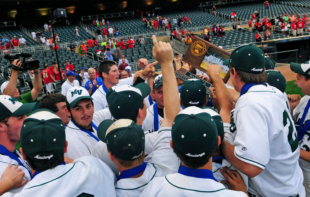. Mounds View players reach out to touch their Class 3A first-place trophy.  (Pioneer Press: Scott Takushi)