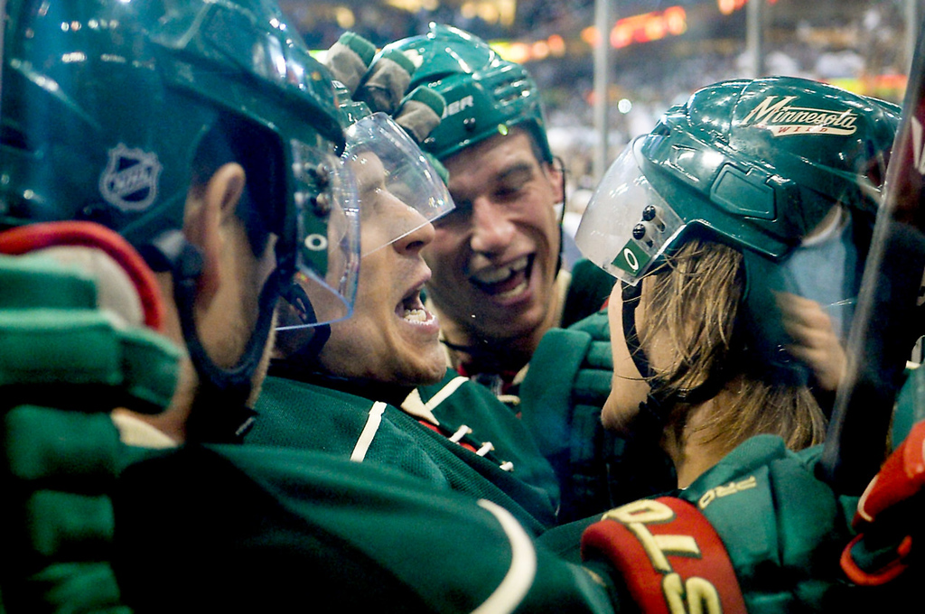 . Minnesota Wild players swarm center Mikael Granlund, right, after he scored the game-winning overtime goal.  (Pioneer Press: Ben Garvin)