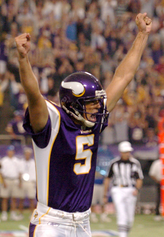 . Viking holder Chris Kluwe celebrates after placekicker Ryan Longwell throws a 16-yard touchdown pass to Richard Owens late in the fourth quarter on a fake field goal play as the Vikings beat the Carolina Panthers at the NMetrodome in Minneapolis on Sunday  September 17, 2006.  (Pioneer Press: John Doman)