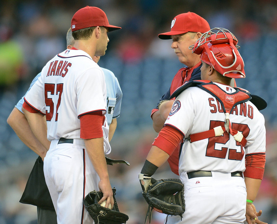 . Washington Nationals pitching coach Steve McCatty, back right, has a word with Washington Nationals starting pitcher Nathan Karns (57), during a rough second inning against the Minnesota Twins, in the second game of a day-night doubleheader. (Chuck Myers/MCT)