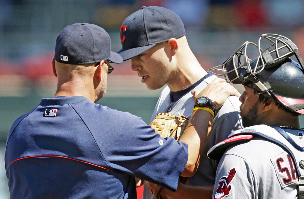 . Indians manager Terry Francona, left, checks on pitcher Justin Masterson, center, shortly after Minnesota\'s Brian Dozier\'s double broke up Masterson\'s no-hit bid in the seventh inning. At right is Cleveland catcher Carlos Santana.  (AP Photo/Jim Mone)