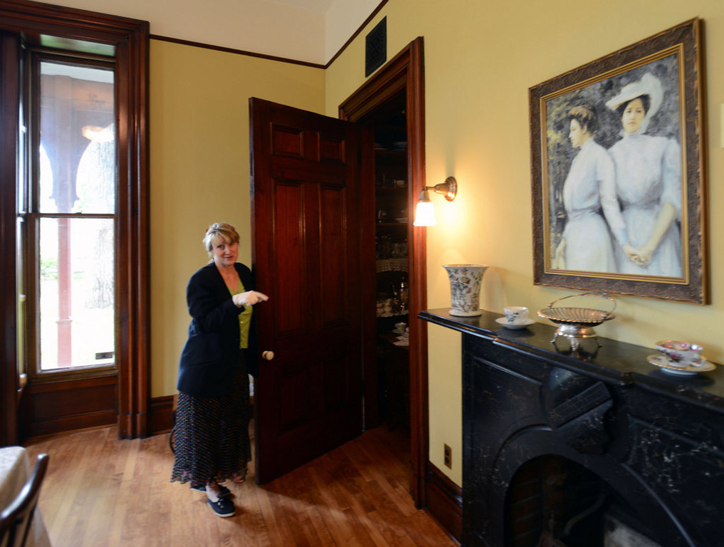 . Tour guide Amy Deaver opens the door to the china cabinet/room off of the main dining room at the LeDuc Historic Estate in Hastings. (Pioneer Press: Chris Polydoroff)