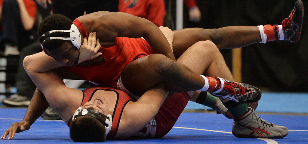 . Cannon Falls senior Clay Broze, bottom, wrestles Benilde-St. Margaret\'s senior Christian DuLaney during the class AA 220 pound State Wrestling Championship at the Xcel Energy Center in St. Paul , Saturday, March 1, 2014. (Pioneer Press: John Autey)