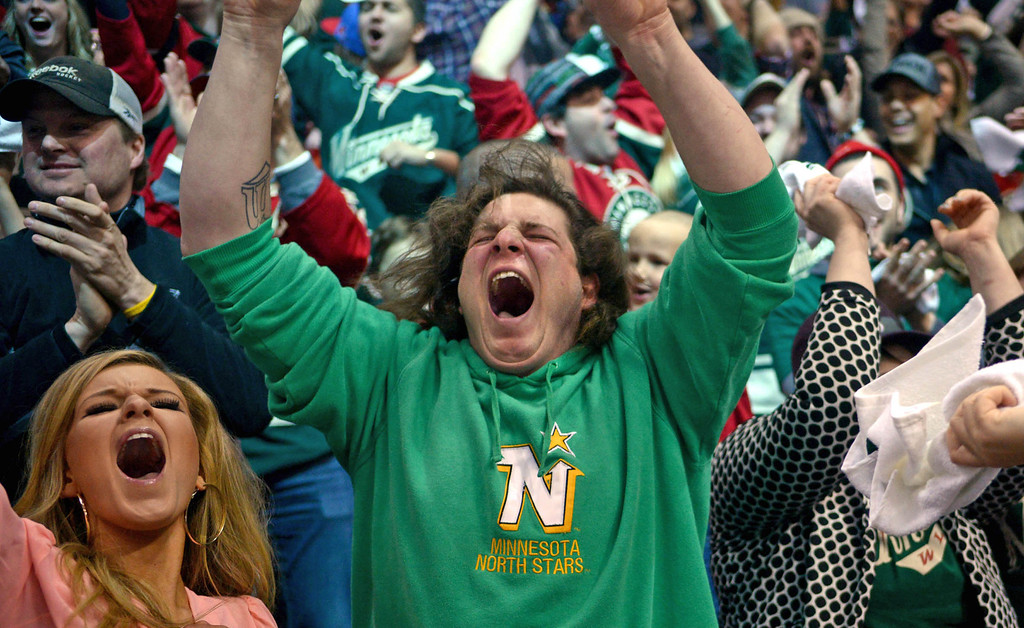 . Fans react after Zach Parise tipped in a Ryan Suter shot for a goal 49 seconds into the first period. (Pioneer Press: Ben Garvin)