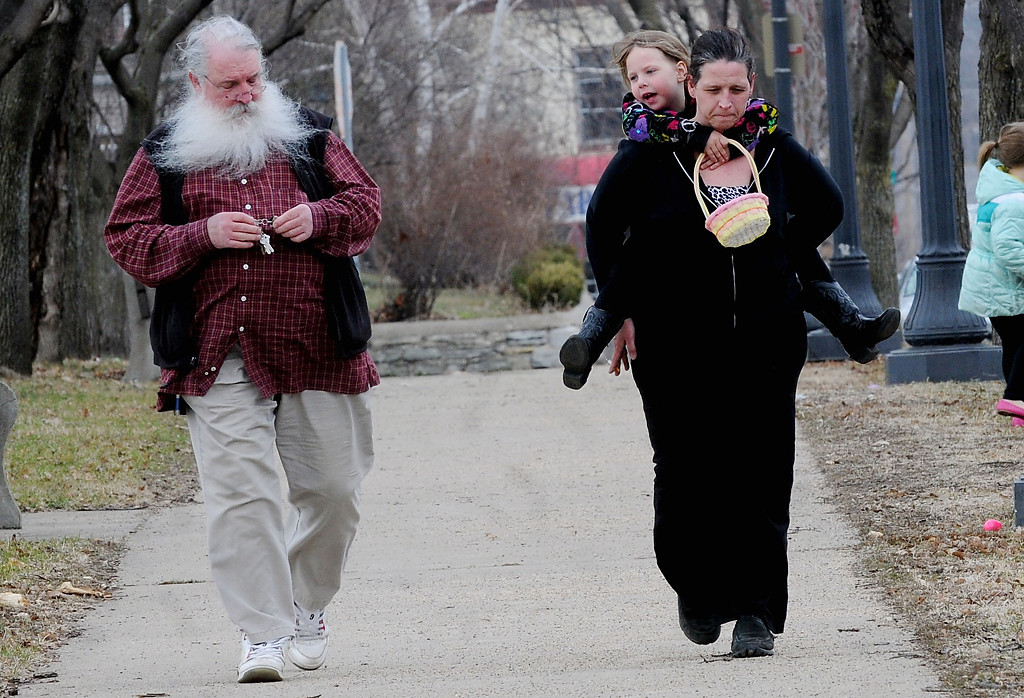 . In Dayton\'s Bluff, residents Shelly Smetana and her daughter, Kloe Hollerbach, 6, walk a few blocks with Kloe\'s grandfather, Jim Smetana, to the annual Easter egg hunt. (Pioneer Press: Sherri LaRose-Chiglo)