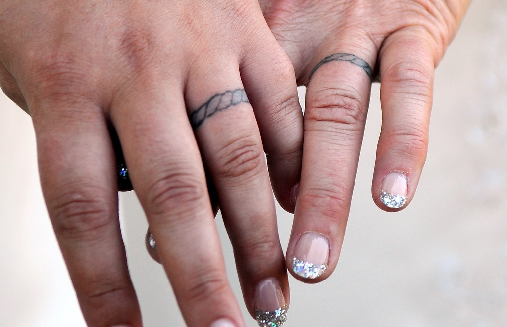 . Shirley and Rochelle show their permanent wedding ring tattoos before their wedding. They also exchanged rings.  (Pioneer Press: Jean Pieri)