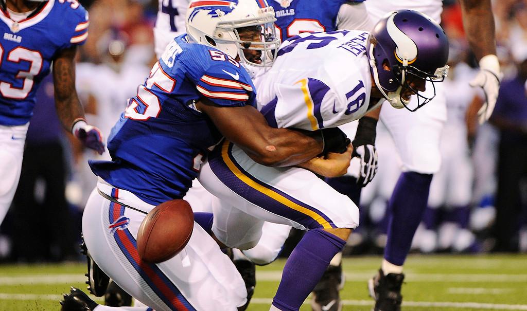 . Buffalo Bills\' Jerry Hughes (55) sacks Minnesota Vikings\' Matt Cassel (16) during the first half of an NFL preseason football game Friday, Aug. 16, 2013, in Orchard Park, N.Y.  (AP Photo/Gary Wiepert)