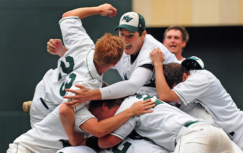 . Mounds View players, including Sam Hentges, top, and Nate Douvier, left, pile on each other after  Mounds View beat Rocori 8-0 to win the State 3A high school baseball championship at Target Field in Minneapolis on Monday, June 17, 2013.  (Pioneer Press: Scott Takushi)