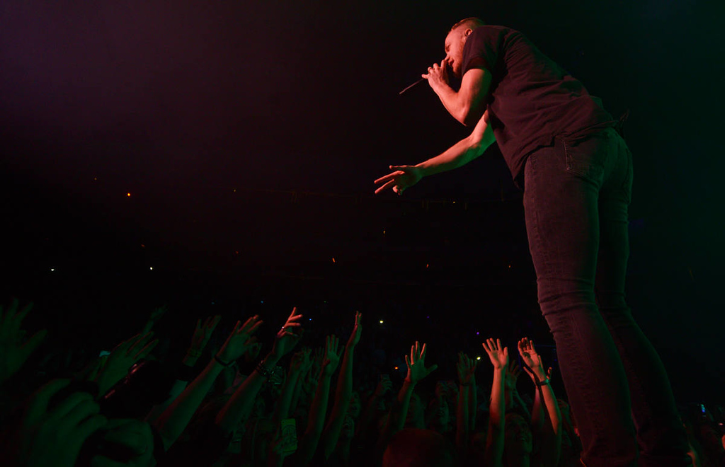 . Front man Dan Reynolds of Imagine Dragons performs during the band\'s \'Into The Night Tour\' stop at the Xcel Energy Center in St. Paul on Wednesday, March 12, 2014. (Pioneer Press: John Autey)