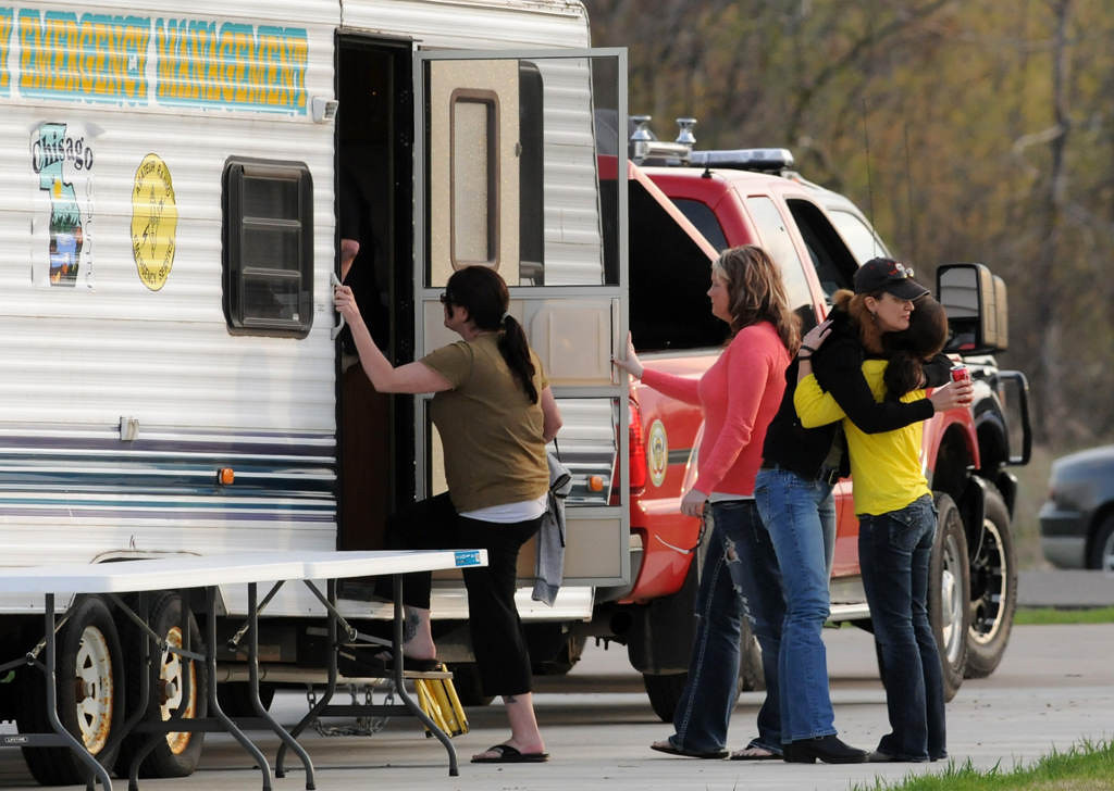 . Cory Jelinek, right, sister of Danielle Jelinek, is hugged before she enters a law enforcement trailer as family gathers close to the site where a body believed to be that of Danielle Jelinek was found in Chisago Township on Friday May 10, 2013.  (Pioneer Press: Jean Pieri)