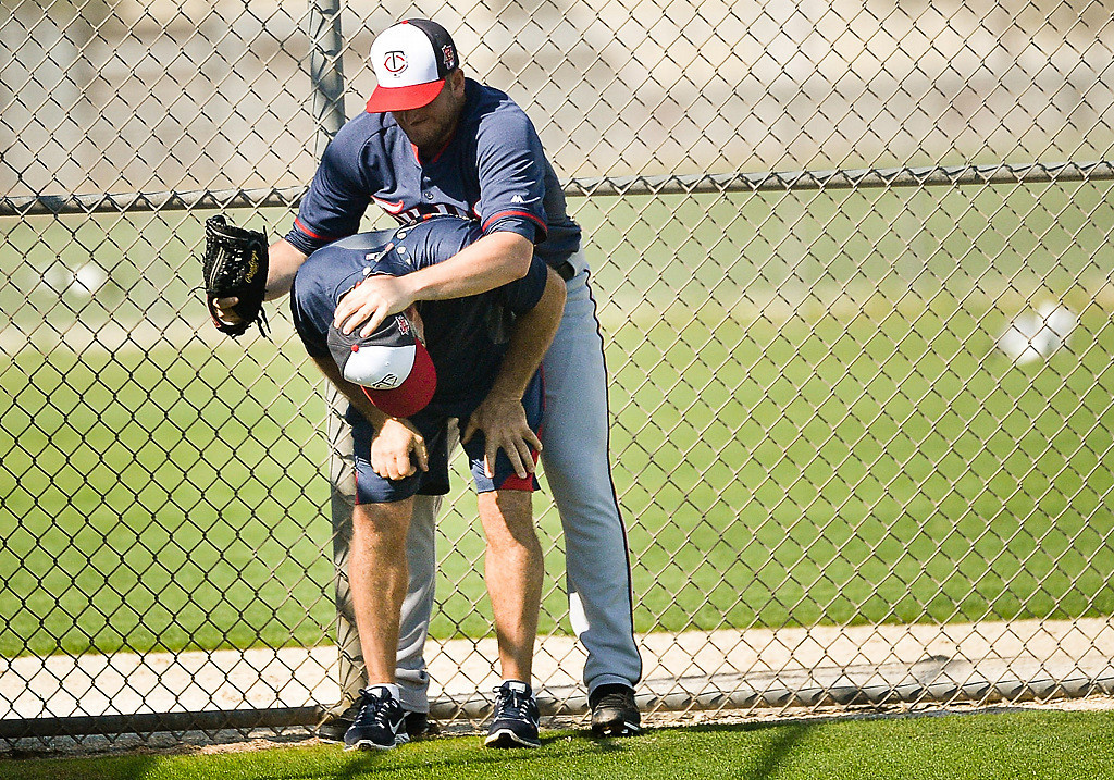 . Pitcher Glenn Perkins goofs off with strength and conditioning coordinator Perry Castellano. (Pioneer Press: Ben Garvin)
