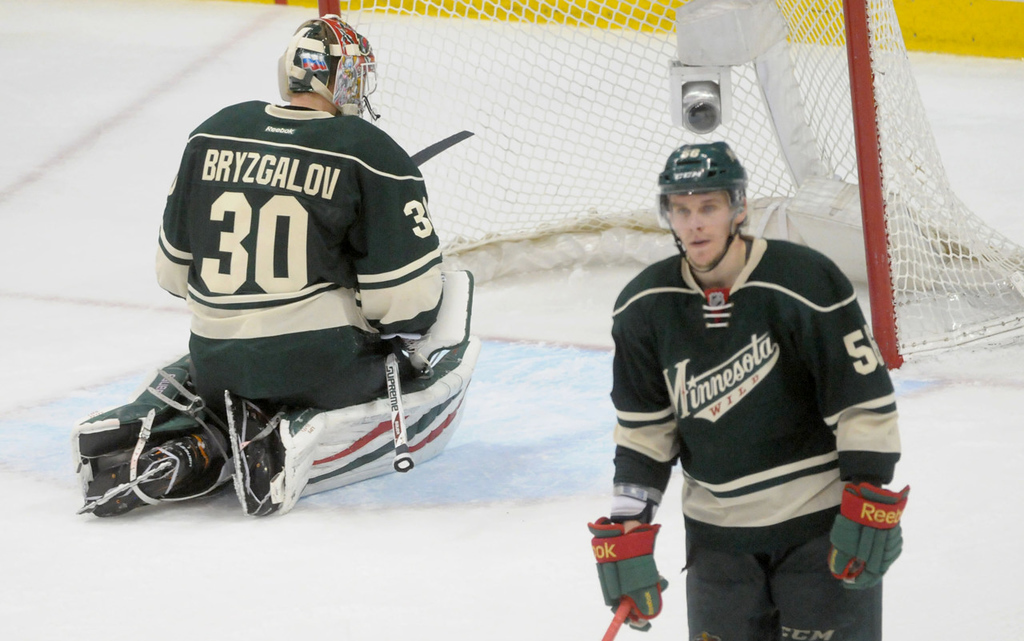 . Wild goalie Ilya Bryzgalov slumps in the crease as he and teammate Erik Haula, right, soak in their 2-1 overtime loss to the Blackhawks.   (Pioneer Press: Sherri LaRose-Chiglo)