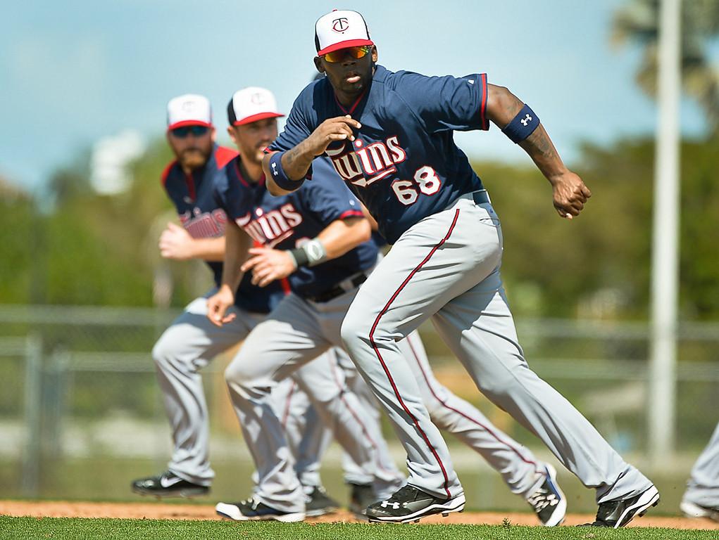 . Twins infielder Kennys Vargas, foreground, and other players run base running drills. (Pioneer Press: Ben Garvin)