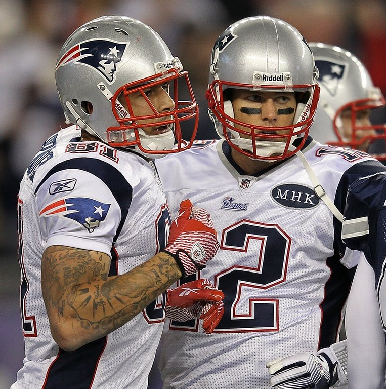 ". <p><b>NEW ENGLAND PATRIOTS</b> <p><i>�TIGHT ENDS�</i> <p>Belichick�s team is a shoo-in for 10 wins  <p>Cause Brady�s a community pillar <p>But they�re missing a lot of their weapons <p>Their offseason proved to be killer <p><b><a href=\'http://www.rollingstone.com/feature/the-gangster-in-the-huddle\' target=""_blank\""> HUH?</a></b> <p>   (Jim Rogash/Getty Images)"