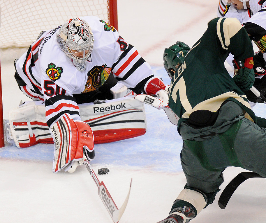 . Chicago goalie Corey Crawford, left, stops a shot from Minnesota center Matt Cullen in the first period. (Pioneer Press: John Autey)