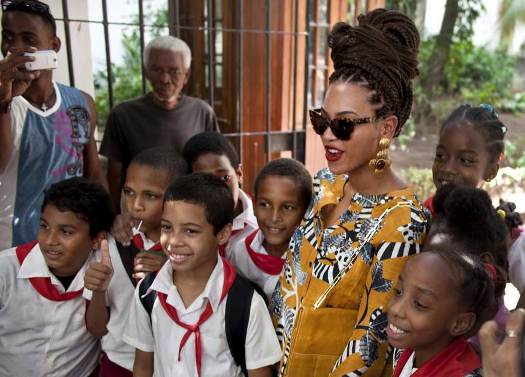 . Beyonce poses for photos with schoolchildren as she tours Old Havana, Cuba, on Thursday, April 4, 2013. Beyonce is in Havana with her husband, rapper Jay-Z, on their fifth wedding anniversary. (Associated Press: Ramon Espinosa)