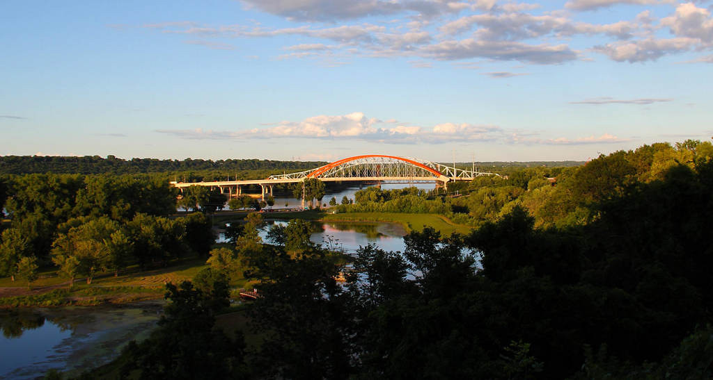 . The sun sets over Lake Rebecca and the Hastings bridges on August 3, 2013. Photo courtesy of Dave Youngren/Hastings Bridge Watch.